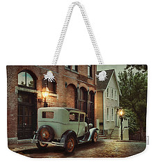 Weekender Tote Bag featuring the photograph Cobblestone Streets by Robin-Lee Vieira