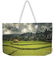 Weekender Tote Bag featuring the photograph Paddy Field by Charuhas Images