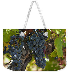 Weekender Tote Bag featuring the photograph Red Vines by Ulrich Schade