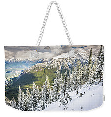 Weekender Tote Bag featuring the photograph Snow In The Trees by Bill Howard