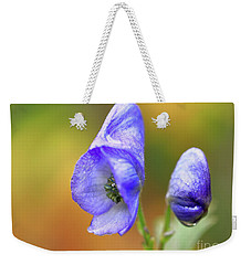 Weekender Tote Bag featuring the photograph Wolf's Bane Flower by Nick Biemans