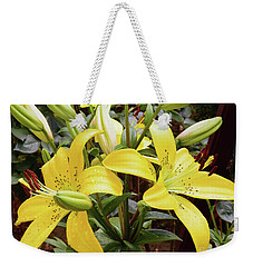 Weekender Tote Bag featuring the photograph Yellow Lily by Elvira Ladocki