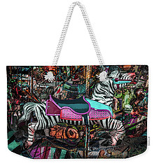 Weekender Tote Bag featuring the photograph Zebra Carousel by Michael Arend