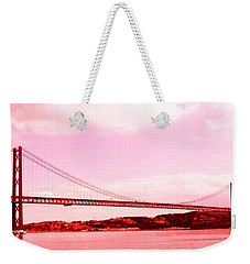 Weekender Tote Bag featuring the photograph 25 De Abril Bridge In Crimson by Lorraine Devon Wilke
