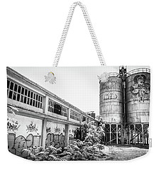 Weekender Tote Bag featuring the photograph Industrial Silos. by Gary Gillette