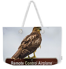 Weekender Tote Bag featuring the photograph Juvenile Red-tailed Hawk by Ricky L Jones