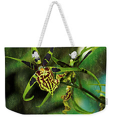 Weekender Tote Bag featuring the photograph Orchid by Richard Goldman