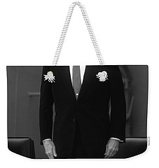 Weekender Tote Bag featuring the photograph President Ronald Reagan by War Is Hell Store