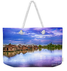 Weekender Tote Bag featuring the photograph Village by Charuhas Images