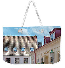 Weekender Tote Bag featuring the photograph Ystad Street Scene by Antony McAulay