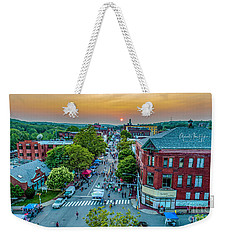 Weekender Tote Bag featuring the photograph 3rd Thursday Sunset by Michael Hughes