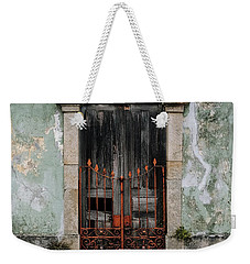 Weekender Tote Bag featuring the photograph Door With No Number by Marco Oliveira