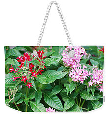 Weekender Tote Bag featuring the photograph Flowers by Rob Hans