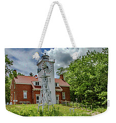Weekender Tote Bag featuring the photograph 40 Mile Point Lighthouse by Bill Gallagher