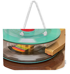 Weekender Tote Bag featuring the photograph 45 Rpm Record In Play Mode by Gary Slawsky