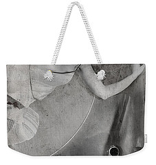 Weekender Tote Bag featuring the photograph The Girl On The Background Of Vintage Car. by Andrey  Godyaykin