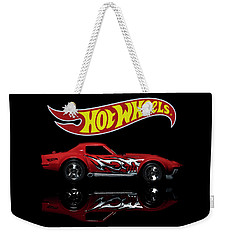 Weekender Tote Bag featuring the photograph '69 Chevy Corvette by James Sage