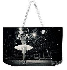 Weekender Tote Bag featuring the photograph A Beautiful Ballerina Dancing In Studio by Dimitar Hristov