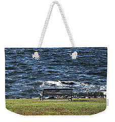 Weekender Tote Bag featuring the photograph A Bench By The Sea by Tom Prendergast