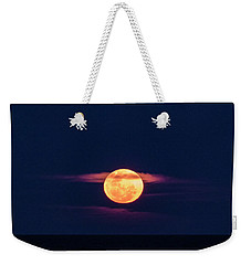 Weekender Tote Bag featuring the photograph A Bloody Moon by Steve Taylor