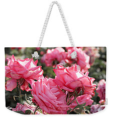 Weekender Tote Bag featuring the photograph A Bunch Of Pink by Laurel Powell