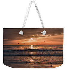 Weekender Tote Bag featuring the photograph A Burnished Sunrise by John M Bailey