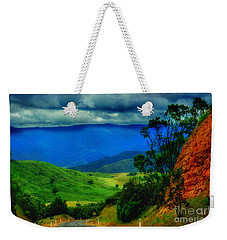 Weekender Tote Bag featuring the photograph  A Country Mile by Blair Stuart