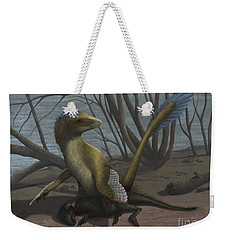 A Deinonychus Protects Its Kill Weekender Tote Bag
