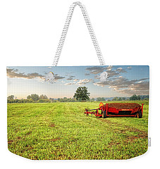 Weekender Tote Bag featuring the photograph A Field At Sunrise by Lars Lentz