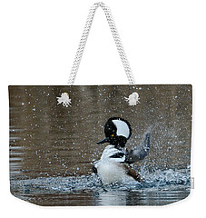 Weekender Tote Bag featuring the photograph A Flurry Of Feathers by Fraida Gutovich