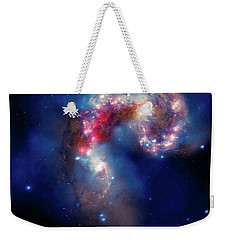 Weekender Tote Bag featuring the photograph A Galactic Spectacle by Marco Oliveira