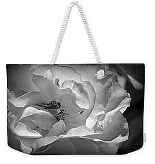 Weekender Tote Bag featuring the photograph A Garden Treasure by Lori Seaman