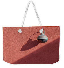 Weekender Tote Bag featuring the photograph A Light Alone by Paul Wear