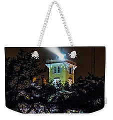 Weekender Tote Bag featuring the photograph A Light In The Darkness by Nick Zelinsky