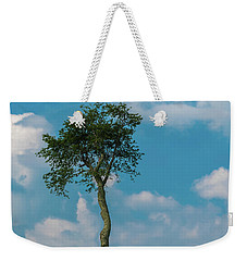 Weekender Tote Bag featuring the photograph A Lonely Tree On A Hill by Guy Whiteley