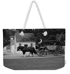 Weekender Tote Bag featuring the photograph A Look Back by Eric Liller