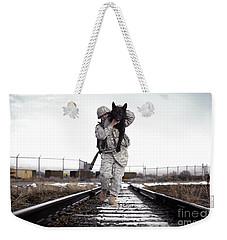 A Military Dog Handler Uses An Weekender Tote Bag