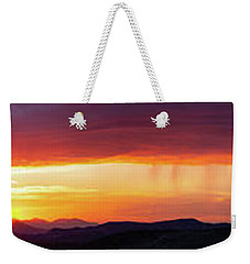 Weekender Tote Bag featuring the photograph  A Moment In Time by Rick Furmanek