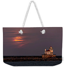 A Moonsetting Sunrise Weekender Tote Bag by Everet Regal