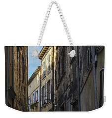 Weekender Tote Bag featuring the photograph A Narrow Street In Viviers by Allen Sheffield