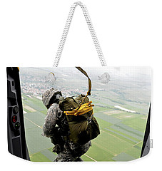 Weekender Tote Bag featuring the photograph A Paratrooper Executes An Airborne Jump by Stocktrek Images