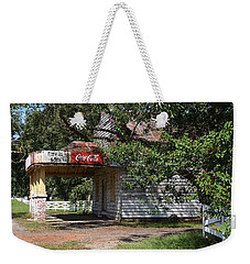 Weekender Tote Bag featuring the photograph A Piece Of The Past by Linda Brown