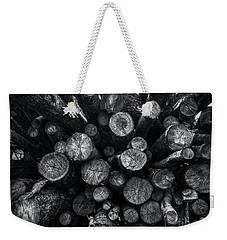 Weekender Tote Bag featuring the photograph A Pile Of Logs by James Aiken