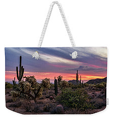 Weekender Tote Bag featuring the photograph A Pink Kissed Desert Sunset  by Saija Lehtonen