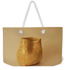 Weekender Tote Bag featuring the photograph A Pot On A Leaf by Itzhak Richter