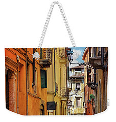 Weekender Tote Bag featuring the photograph A Pretty Little Street In Verona Italy  by Carol Japp