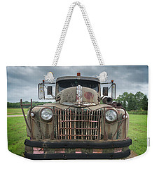 Weekender Tote Bag featuring the photograph A Really Rusty Ford by Guy Whiteley