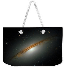 Weekender Tote Bag featuring the photograph Fastest Spinning Galaxy by Nicholas Burningham