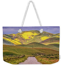 Weekender Tote Bag featuring the photograph A Road Less Traveled by Marc Crumpler