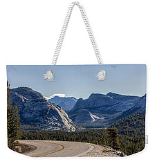 Weekender Tote Bag featuring the photograph A Road To Follow by Everet Regal